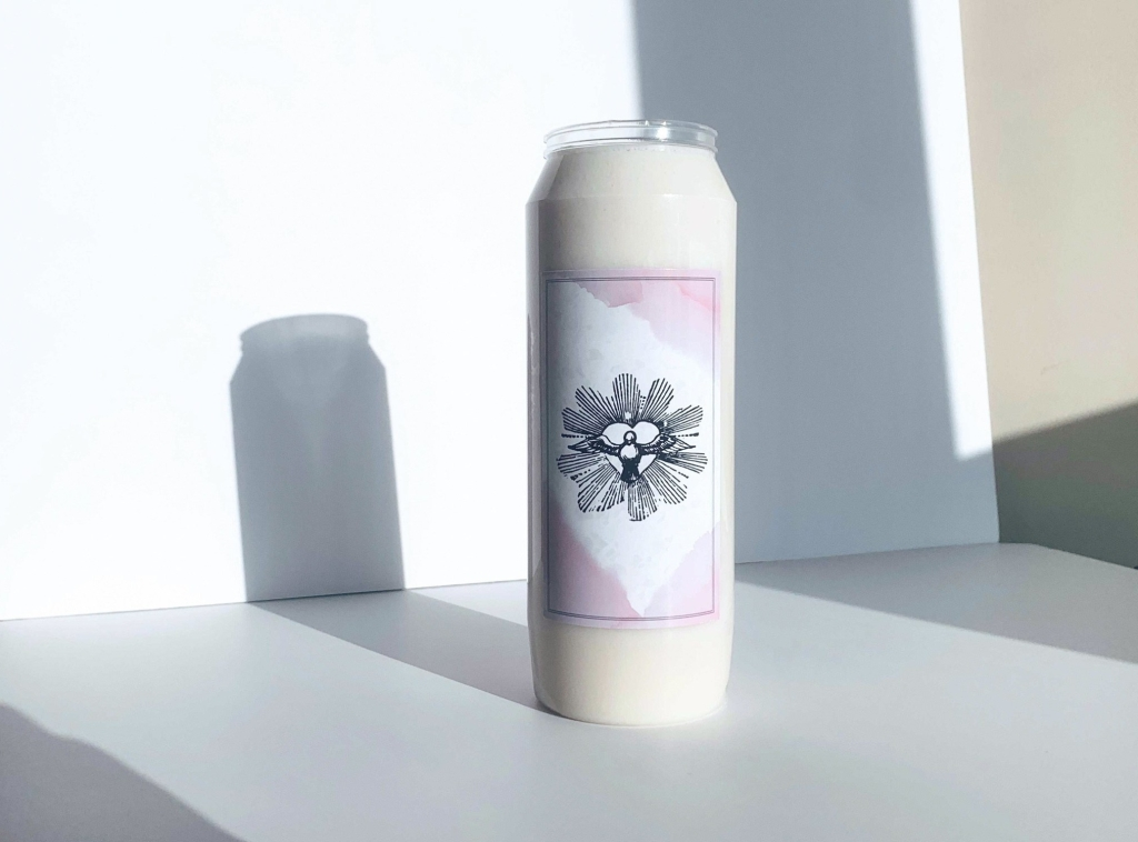 White prayer candle featuring pink watercolor graphic with dove